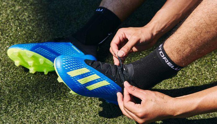 Cách buộc dây giày đá bóng không bị tuột